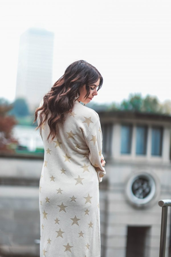 Two Outfits Perfect for Thanksgiving Dinner | Greta Hollar | Two Perfect Thanksgiving Dinner Outfits by popular Nashville fashion blogger, Greta Hollar: image of a woman outside wearing a Chaser Brand STAR INTARSIA DUSTER.