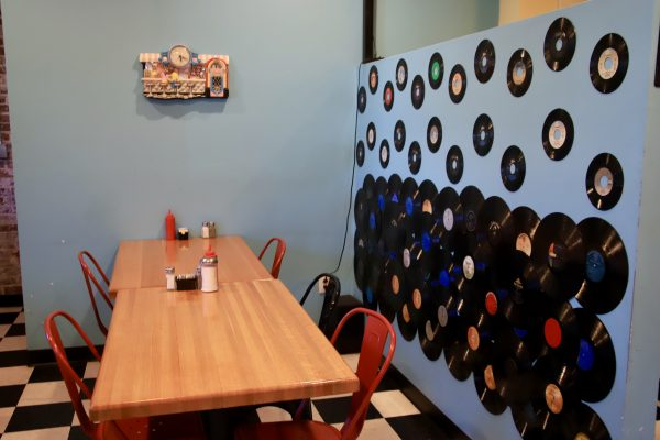A Couples Getaway to Hohenwald, TN | Greta Hollar | A Couples Getaway: Things to do in Hohenwald TN by popular Nashville travel blogger, Greta Hollar: image of Hank's Family Diner interior with vinyl records on the wall.