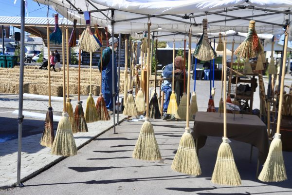A Couples Getaway to Hohenwald, TN | Greta Hollar | A Couples Getaway to Hohenwald, TN | Greta Hollar | A Couples Getaway: Things to do in Hohenwald TN by popular Nashville travel blogger, Greta Hollar: image of handmade brooms at the Oktober heritage festival.