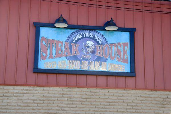 A Couples Getaway to Hohenwald, TN   Greta Hollar   A Couples Getaway: Things to do in Hohenwald TN by popular Nashville travel blogger, Greta Hollar: image of Junk Yard Dog Steak House.