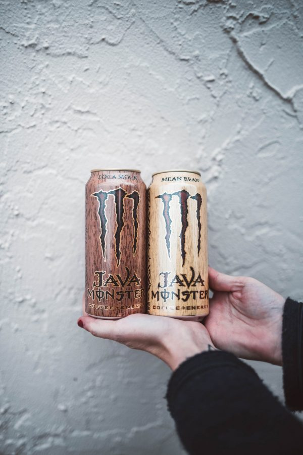 How to Stay Energized Through the Holiday Season by popular Nashville life and style blogger, Greta Hollar: image of a woman holding two Java Monster Energy Drinks.