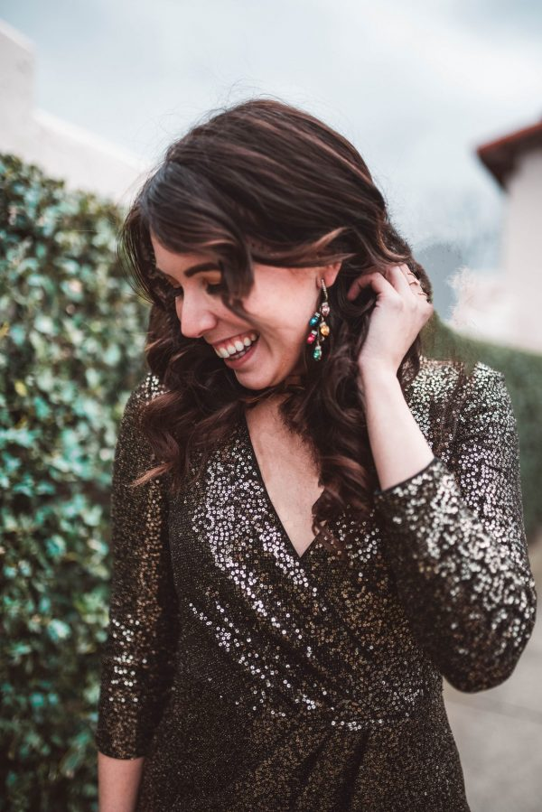 2 New Year's Eve Outfit Ideas by popular Nashville fashion blogger, Greta Hollar: image of a woman wearing an Eliza J. sequin dress and Bauble Bar TRIMMINGS DROP EARRINGS.