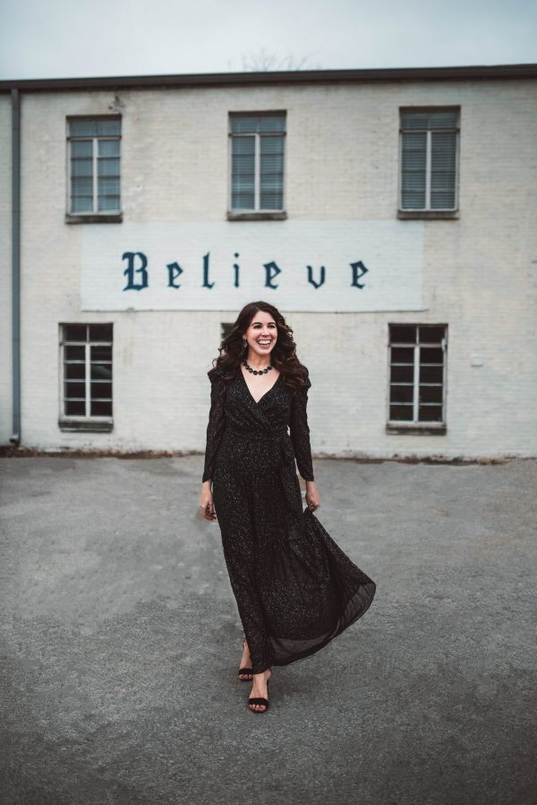 2 Outfit Ideas for New Year's Eve | Greta Hollar | 2 New Year's Eve Outfit Ideas by popular Nashville fashion blogger, Greta Hollar: image of a woman wearing an Eliza J. ELIZA J Long Sleeve Faux Wrap Chiffon Maxi Dress, Main, color, BLACK Long Sleeve Faux Wrap Chiffon Maxi Dress, Kendra Scott Jolie Drop Earrings, and Kendra Scott Jolie Statement Necklace Jolie Statement Necklace Jolie Statement Necklace.