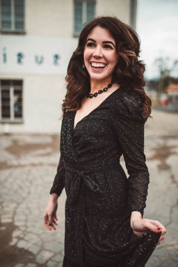 2 New Year's Eve Outfit Ideas by popular Nashville fashion blogger, Greta Hollar: image of a woman wearing an Eliza J. ELIZA J Long Sleeve Faux Wrap Chiffon Maxi Dress, Main, color, BLACK Long Sleeve Faux Wrap Chiffon Maxi Dress, Kendra Scott Jolie Drop Earrings, and Kendra Scott Jolie Statement Necklace Jolie Statement Necklace Jolie Statement Necklace.
