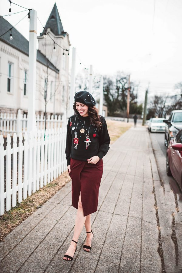 5 of My Favorite Christmas Sweaters | Greta Hollar | 5 of My Favorite Cute Christmas Sweaters by popular Nashville fashion blogger, Greta Hollar: image of a woman outside wearing a Nordstrom TopShop Sequin Nutcracker Sweater, Nordstrom Nic + Zoe Push the Pencil Skirt, and Romwe Chenille Plain Beret Cap.