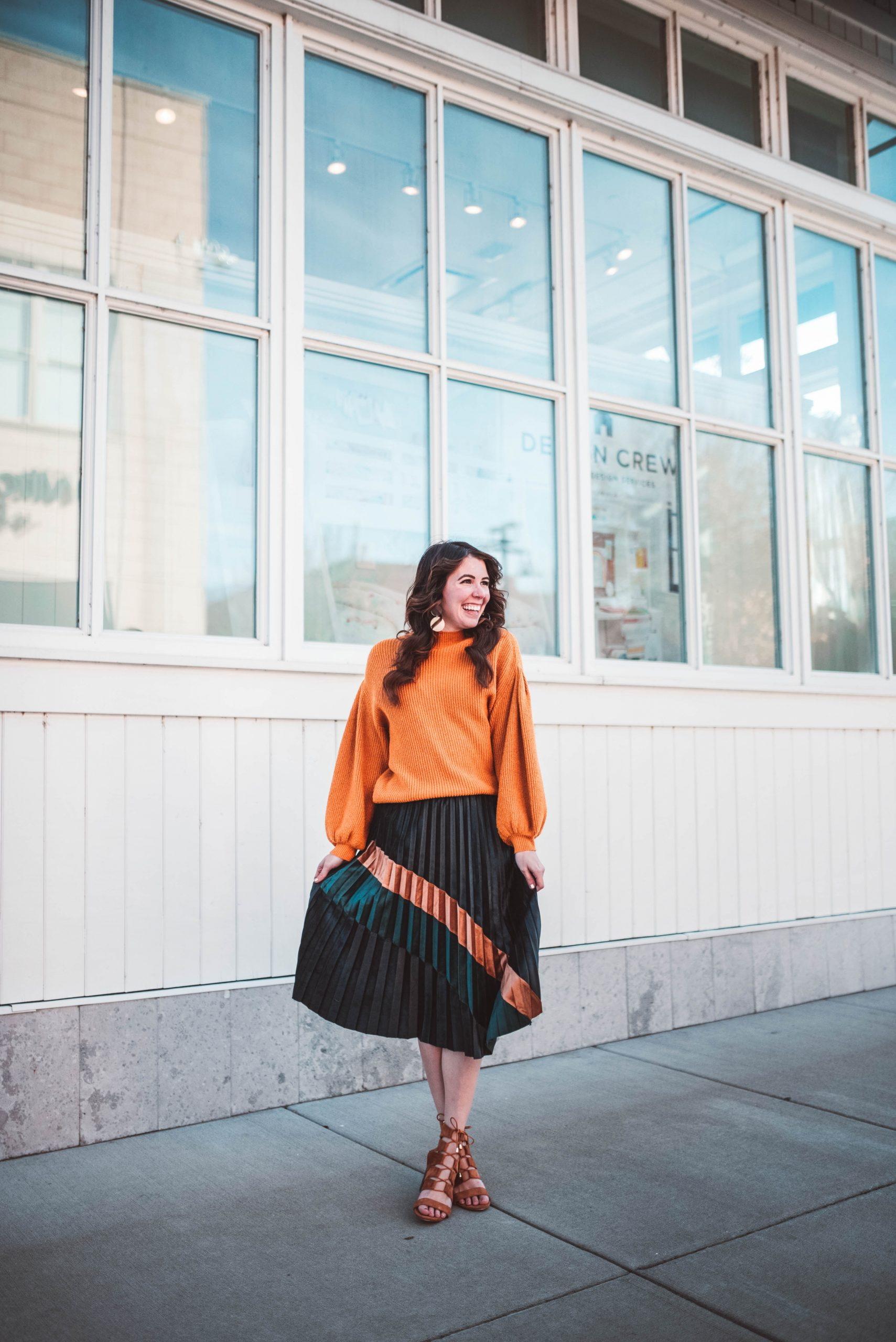 Cold Weather Party Outfit by popular Nashville fashion blogger, Greta Hollar: image of a woman wearing a Chic Wish Bronze and Emerald Color Splicing Velvet Pleated Skirt, Revolve Turtleneck Cable Knit Pullover Sweater, and Milanoo Brown Gladiator Sandals Suede Open Toe Lace Up Ankle Strap Sandals High Heel Sandal Shoes.