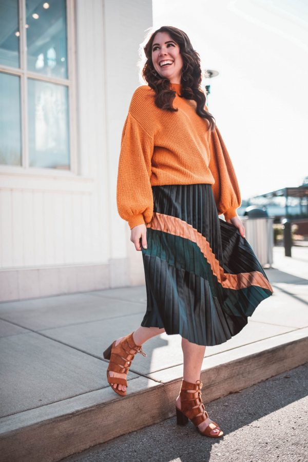 Cold Weather Party Outfit | Greta Hollar | Cold Weather Party Outfit by popular Nashville fashion blogger, Greta Hollar: image of a woman wearing a Chic Wish Bronze and Emerald Color Splicing Velvet Pleated Skirt, Revolve Turtleneck Cable Knit Pullover Sweater, and Milanoo Brown Gladiator Sandals Suede Open Toe Lace Up Ankle Strap Sandals High Heel Sandal Shoes.
