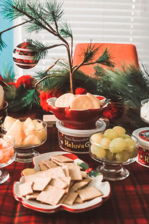 Holiday Game Night Essentials | Greta Hollar | Holiday Game Night Essentials by popular life and style blogger, Greta Hollar: image of a table with various food items on it as well as various Heluva Good! dips.