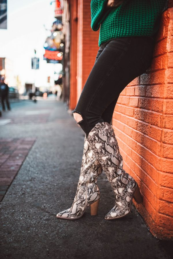 The 5 Best Boot Brands for Skinny Legs | Greta Hollar | The 5 Best Boots for Skinny Legs by popular Nashville fashion blogger, Greta Hollar: image of a woman wearing tall snake skin print boots.