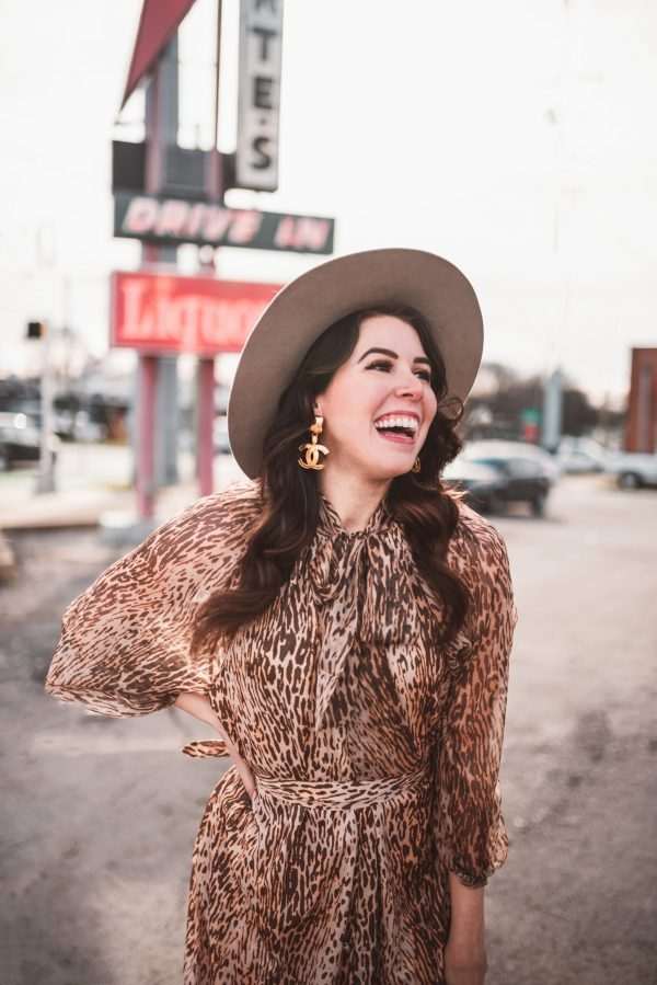 Top 5 Designer Consignment Websites to Buy Your Favorite Second Hand Designer Items | Greta Hollar | Top 5 Designer Consignment Websites to Buy Your Favorite Second Hand Designer Items by popular Nashville tall fashion blogger, Greta Hollar: image of a woman wearing Channel earrings.