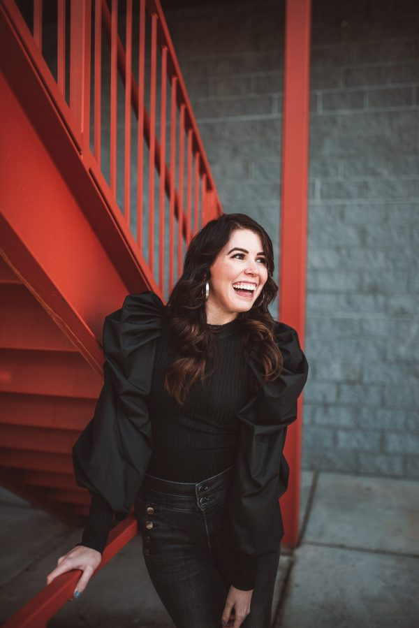 How to Get Your Wardrobe Ready for NYFW   Greta Hollar   Figuring Out NYFW Packing Essentials by popular Nashville tall fashion blogger, Greta Hollar: image of a woman standing on a red staircase and wearing an all black outfit.