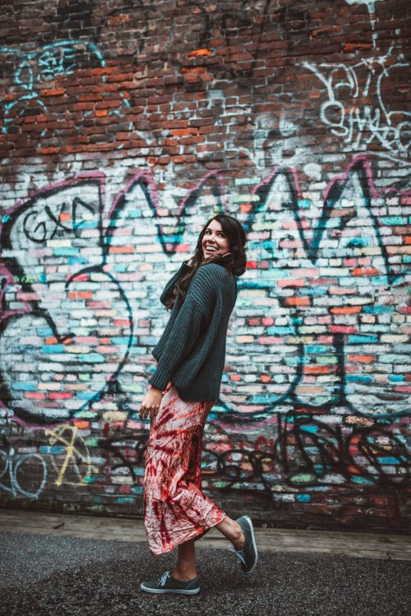 How to Wear the Tie Dye Trend this Spring: 5 Creative Ways   Greta Hollar   How to Wear the Tie Dye Trend this Spring: 5 Creative Ways by popular Nashville tall fashion blogger, Greta Hollar: image of a woman wearing a Free People Serious Swagger Tie Dye Skirt, Target A New Day Women's Cateye Sunglasses, Journey's Womens Keds Champion Original Casual Shoe, Aerie sweater and Kendra Scott Russel Hoop Earrings.