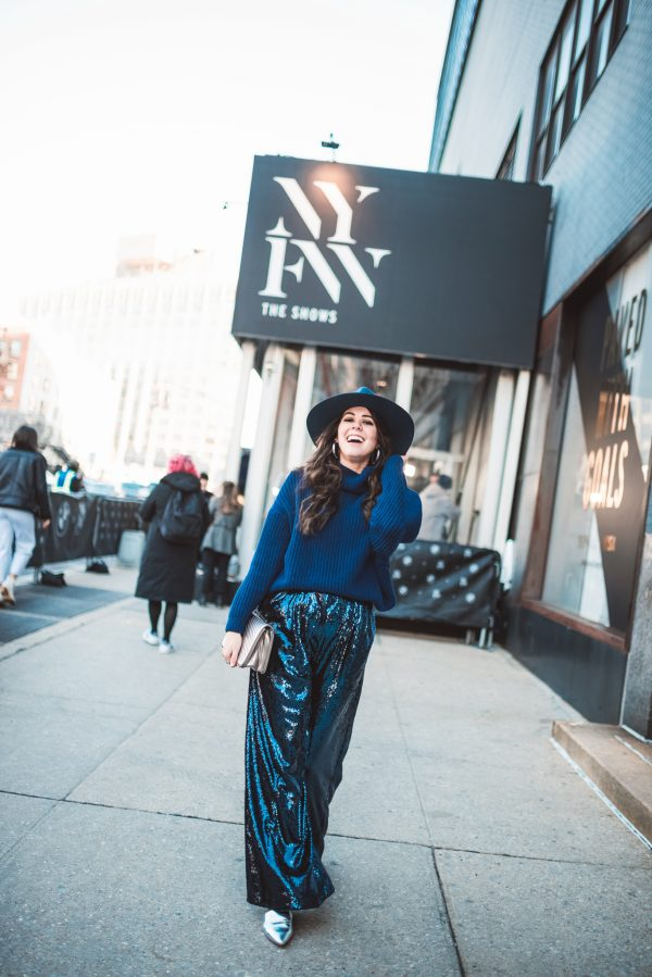 How to Wear Sequins in the Winter | Greta Hollar | How to Wear Sequins in the Winter by popular Nashville tall fashion blogger, Greta Hollar: image of a woman wearing a Nordstrom The Fleur High Crown Wool Fedora LACK OF COLOR, ASOS ASOS EDITION sequin wide leg flare pants, and Free People Cocoa Sweater.