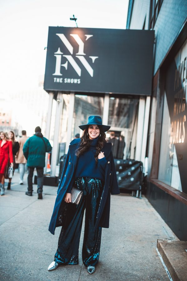 5 NYFW Outfits I Wore During Fashion Week | Greta Hollar | How to Wear Sequins in the Winter by popular Nashville tall fashion blogger, Greta Hollar: image of a woman wearing a Nordstrom The Fleur High Crown Wool Fedora LACK OF COLOR, ASOS ASOS EDITION sequin wide leg flare pants, and Free People Cocoa Sweater.