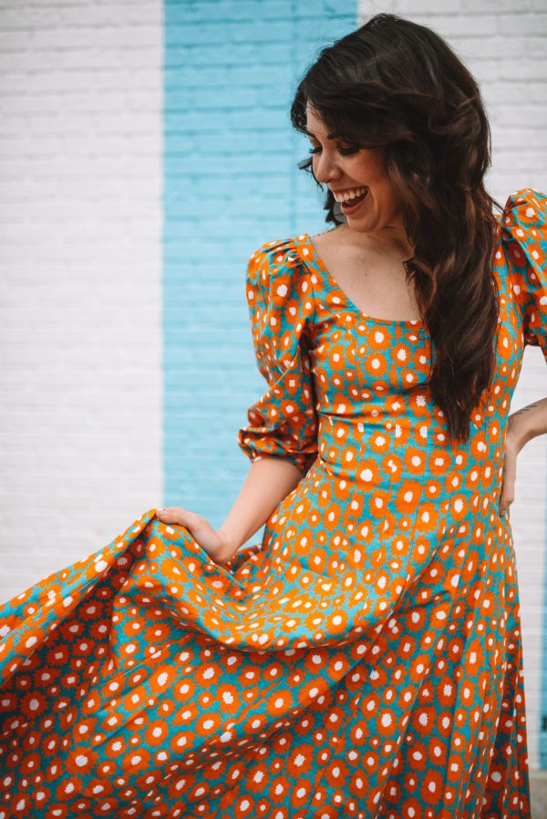 Top 3 Must Have Staud Favorites for Spring | Greta Hollar | Orange Clothing by popular Nashville tall fashion blogger, Greta Hollar: image of Greta Hollar wearing a Staud daisy dress.