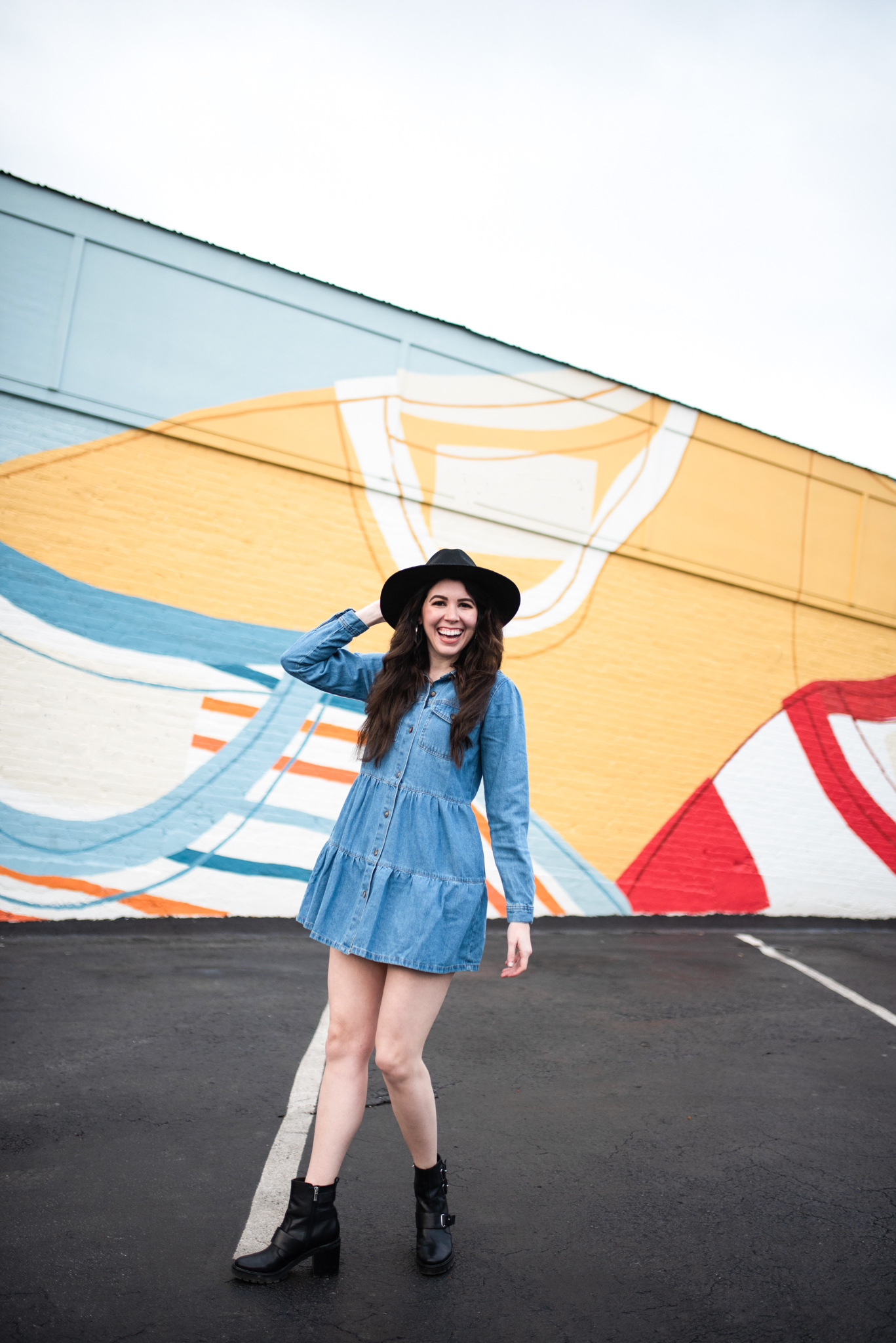 What to Wear in Nashville by popular Nashville tall fashion blogger, Greta Hollar: image of Greta Hollar wearing a denim shirt dress.