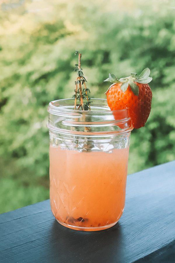 Berry Margarita Recipe | Greta Hollar | Mixed Berry Margarita Recipe by popular lifestyle blogger, Greta Hollar: image of a mixed berry margarita in a mason jar.