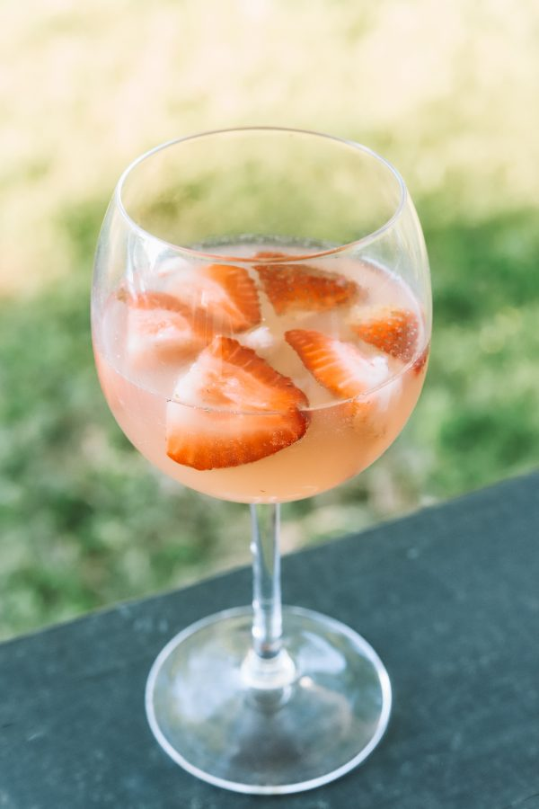 Summer Cocktail Ideas: Light & Refreshing Rosé Cocktail | Greta Hollar | Rosé Cocktail Recipe by popular Nashville lifestyle blogger, Greta Hollar: image of a wine glass with a rose cocktail.
