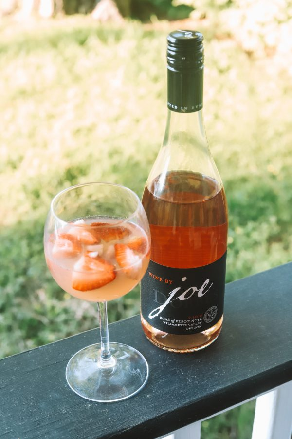 Summer Cocktail Ideas: Light & Refreshing Rosé Cocktail | Greta Hollar | Rosé Cocktail Recipe by popular Nashville lifestyle blogger, Greta Hollar: image of a Wine by Joe bottle and a wine glass with a rose cocktail.