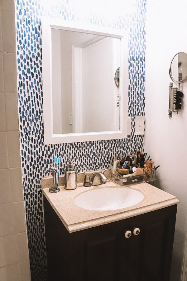 Sherwin Williams Bathroom Paint Ideas by popular Nashville life and style blogger Greta Hollar: after image of a bathroom that was painted with Sherwin Williams Emerald paint line.