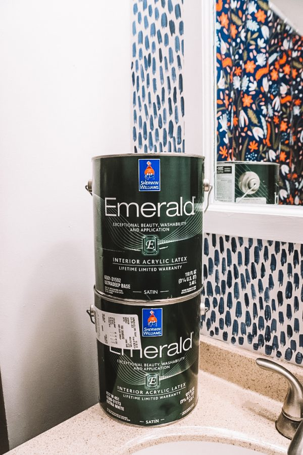 Sherwin Williams Bathroom Paint Ideas by popular Nashville life and style blogger Greta Hollar: image of Sherwin Williams Emerald paint cans.