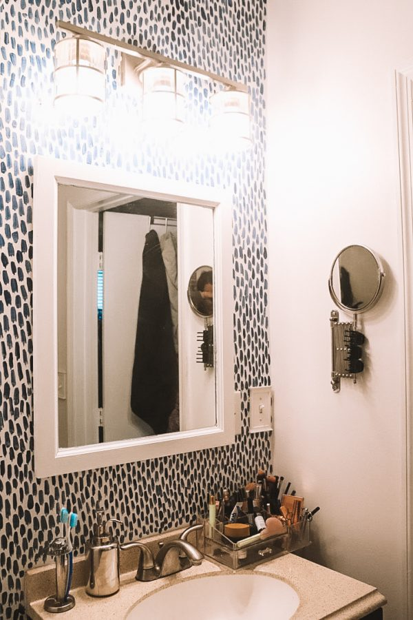 Before and After: DIY Bathroom Makeover with Sherwin Williams | Greta Hollar | Sherwin Williams Bathroom Paint Ideas by popular Nashville life and style blogger Greta Hollar: after image of a bathroom that was painted with Sherwin Williams Emerald paint line.