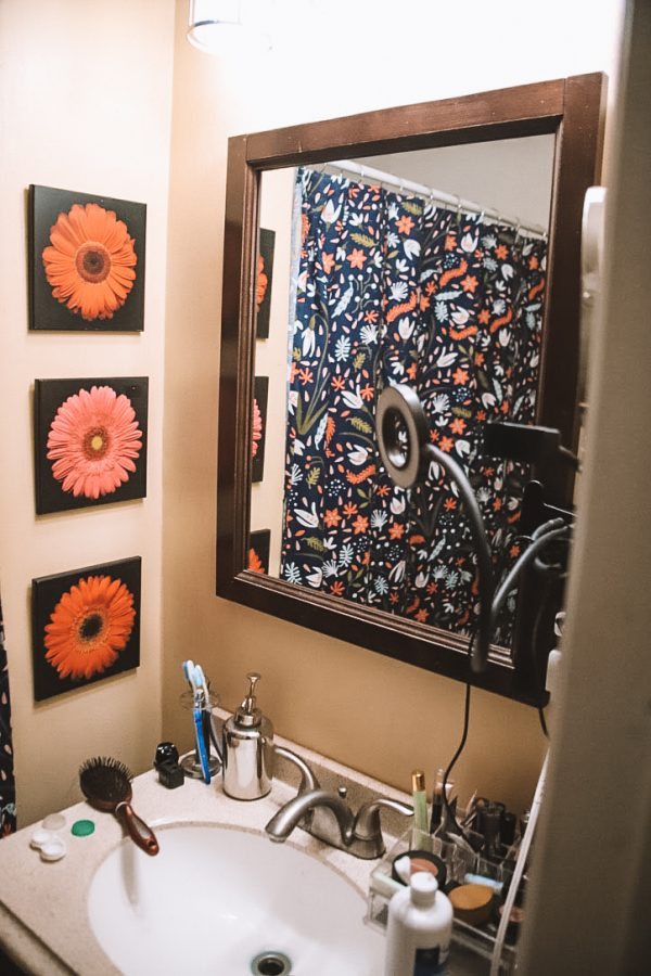 Before and After: DIY Bathroom Makeover with Sherwin Williams | Greta Hollar | Sherwin Williams Bathroom Paint Ideas by popular Nashville life and style blogger Greta Hollar: before image of a bathroom.