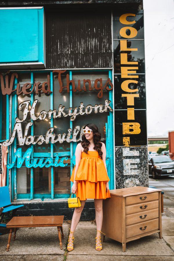 Orange Summer Fashion: Top 12 Pieces to Wear this Season | Greta Hollar | Orange Clothing by popular Nashville tall fashion blogger, Greta Hollar: image of Greta Hollar wearing an orange ruffle mini dress.