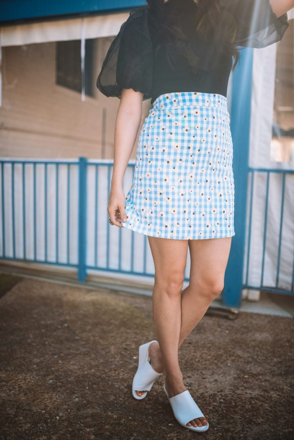 The Perfect Blue Daisy Skirt for Summer | Greta Hollar | Blue Daisy Skirt by popular Nashville fashion blogger, Greta Hollar: image of Greta Hollar wearing a ChicWish ORGANZA BUBBLE SLEEVES KNIT TOP IN BLACK, ChicWish blue daisy skirt, and Nordstrom Perky Wedge Slide Sandal SEYCHELLES.