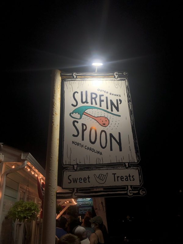 COVID Travel: The Best Things to Do Outer Banks, NC When Social Distancing | Greta Hollar |  Outer Banks NC by popular Nashville travel blogger, Greta Hollar: image of the Surfin' Spoon sign.
