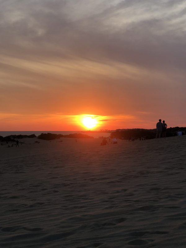 COVID Travel: The Best Things to Do Outer Banks, NC When Social Distancing | Greta Hollar |  Outer Banks NC by popular Nashville travel blogger, Greta Hollar: image of some Outer Banks sand dunes at sunset.