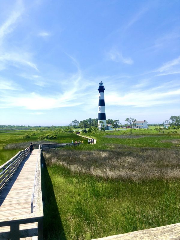 COVID Travel: The Best Things to Do Outer Banks, NC When Social Distancing | Greta Hollar |  Outer Banks NC by popular Nashville travel blogger, Greta Hollar: image of Bodie Island lighthouse.