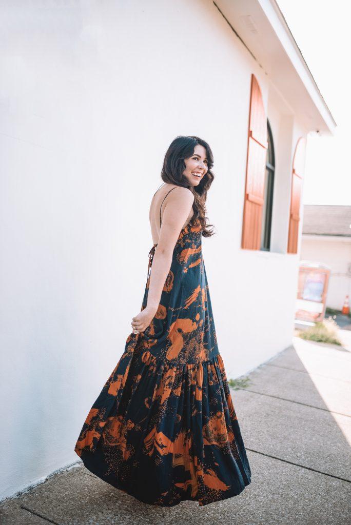 H&M Summer Favorites: 7 Top Picks for Women | Greta Hollar |Spring 2021 Fashion Trends by popular Nashville tall fashion blogger, Greta Hollar: image of Greta Hollar wearing blue and bold orange print maxi dress.