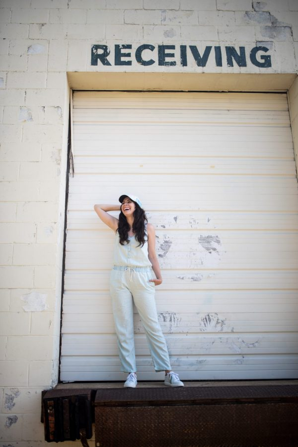 Top 7 Amaryllis Apparel Favorites for the Tall Girl | Greta Hollar | Amaryllis Apparel by popular Nashville tall fashion blogger, Greta Hollar: image of a woman walking outside and wearing a Amaryllis Charlie Chambray Jumpsuit.