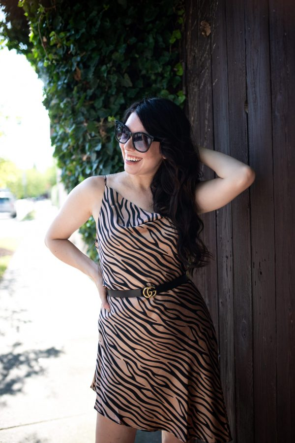 Top 7 Amaryllis Apparel Favorites for the Tall Girl | Greta Hollar | Amaryllis Apparel by popular Nashville tall fashion blogger, Greta Hollar: image of a woman walking outside and wearing a Amaryllis Tiger Tilt Dress and Gucci belt.
