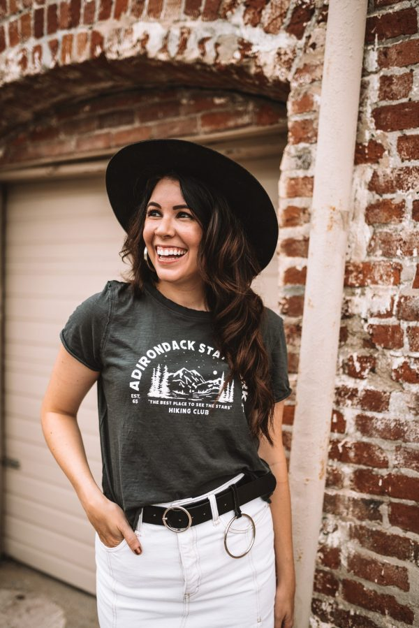 Top 5 Graphic Tees to Wear This Fall | Greta Hollar | Graphic Tees by popular Nashville tall fashion blogger, Greta Hollar: image of Greta Hollar wearing a Nashville guitar graphic tee, black hat, and white denim skirt.