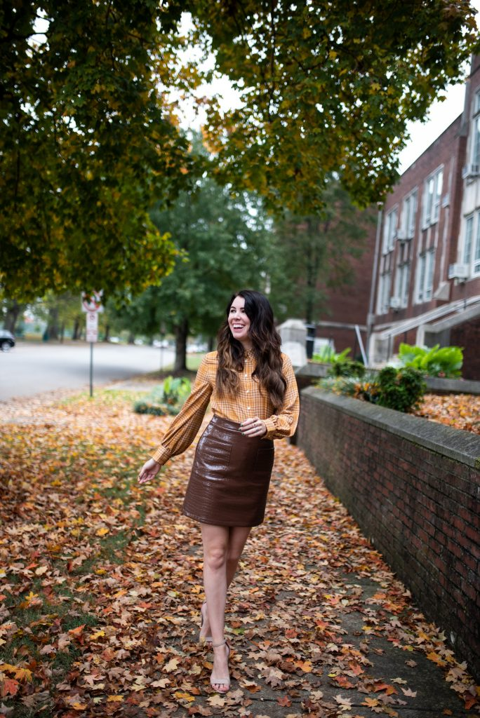 Thanksgiving Outfit Ideas by popular Nashville tall fashion blogger, Greta Hollar: image of Greta Hollar wearing a Halogen x Atlantic-Pacific Croc Embossed Faux Leather Miniskirt and Halogen x Atlantic-Pacific Puff Sleeve Button-Up Shirt.