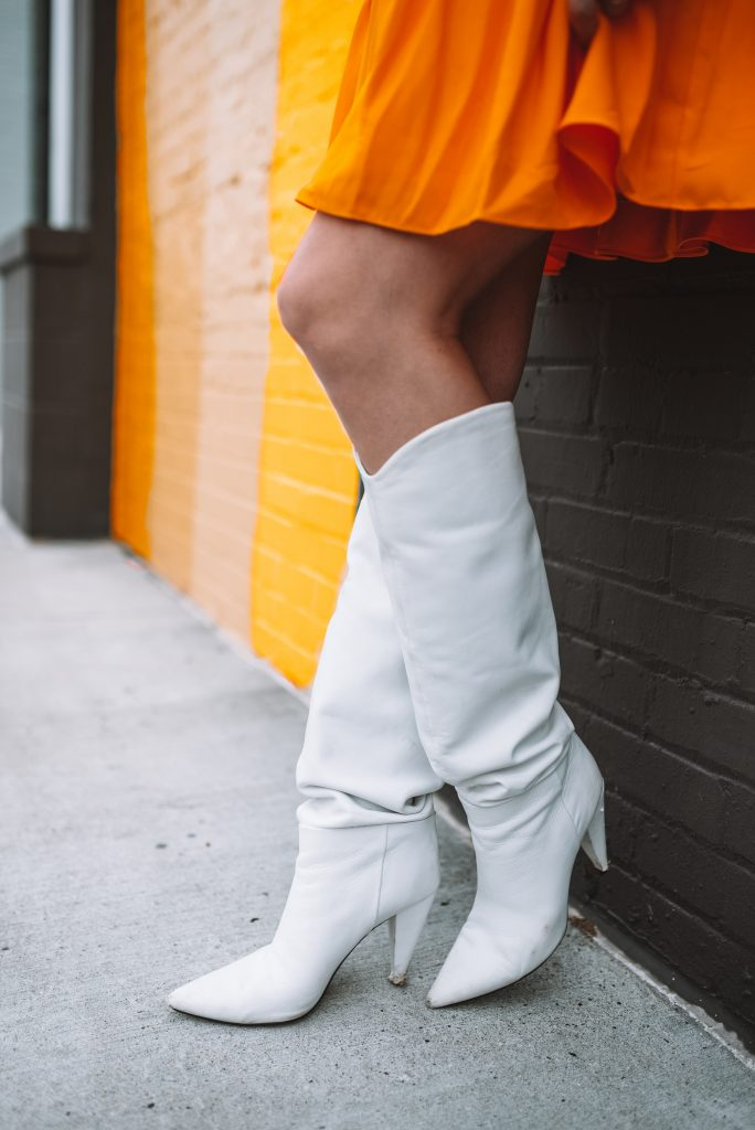 2 Cute Thanksgiving Looks from the Halogen Nordstrom Collaboration | Greta Hollar |Thanksgiving Outfit Ideas by popular Nashville tall fashion blogger, Greta Hollar: image of Greta Hollar wearing a Halogen x Atlantic-Pacific Belted Long Sleeve Shirtdress, white tassel earrings and white boots.