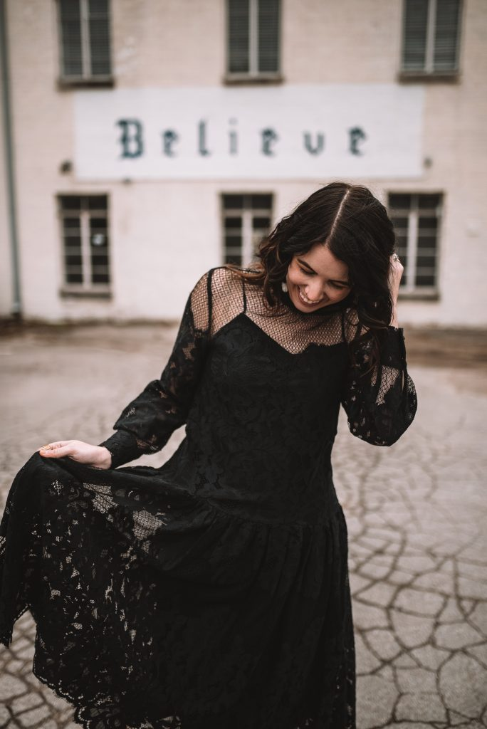 5 New Year's Eve Outfit Ideas to Celebrate at Home | Greta Hollar | New Years Eve Outfits by popular tall fashion blogger, Greta Hollar: image of a woman wearing a black lace dress.