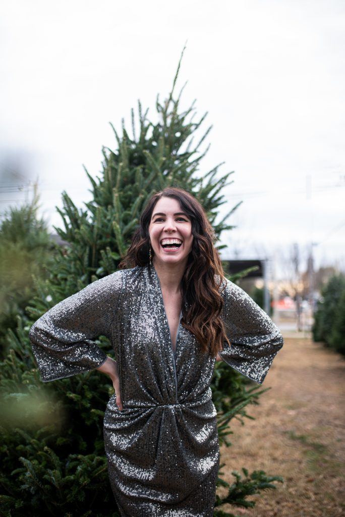 5 New Year's Eve Outfit Ideas to Celebrate at Home | Greta Hollar |New Years Eve Outfits by popular tall fashion blogger, Greta Hollar: image of a woman wearing a silver sequin dress.