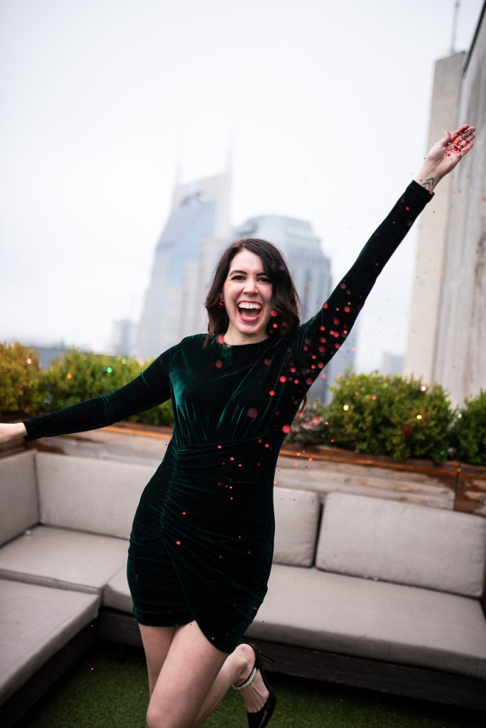 5 New Year's Eve Outfit Ideas to Celebrate at Home | Greta Hollar |New Years Eve Outfits by popular tall fashion blogger, Greta Hollar: image of a woman wearing a green velvet dress.