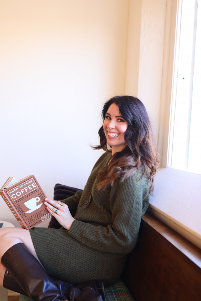 Top 10 Cute Winter Sweaters from Madewell | Greta Hollar |Top 10 Cute Winter Sweaters from Madewell | Greta Hollar | Cute Winter Sweaters by popular Nashville tall fashion blogger, Greta Hollar: image of Greta Hollar sitting down and wearing a green Madewell sweater and brown knee high boots.
