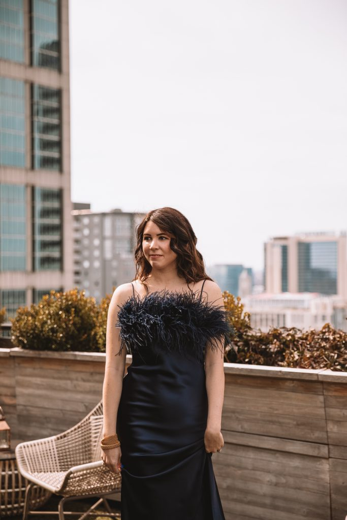 4 Dresses That are Perfect for Spring | Greta Hollar |Spring Dresses by popular Nashville tall fashion blogger, Greta Hollar: image of Greta Hollar  wearing a stain feathered dress.