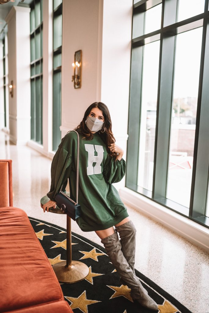 St. Patrick's Day Fashion 3 Outfit Ideas for Tall Women | Greta Hollar |Greta Hollar | St. Patrick's Day Fashion by popular Nashville tall fashion blogger, Greta Hollar: image of Greta Hollar wearing a green sweatshirt dress and grey suede over the knee boots.