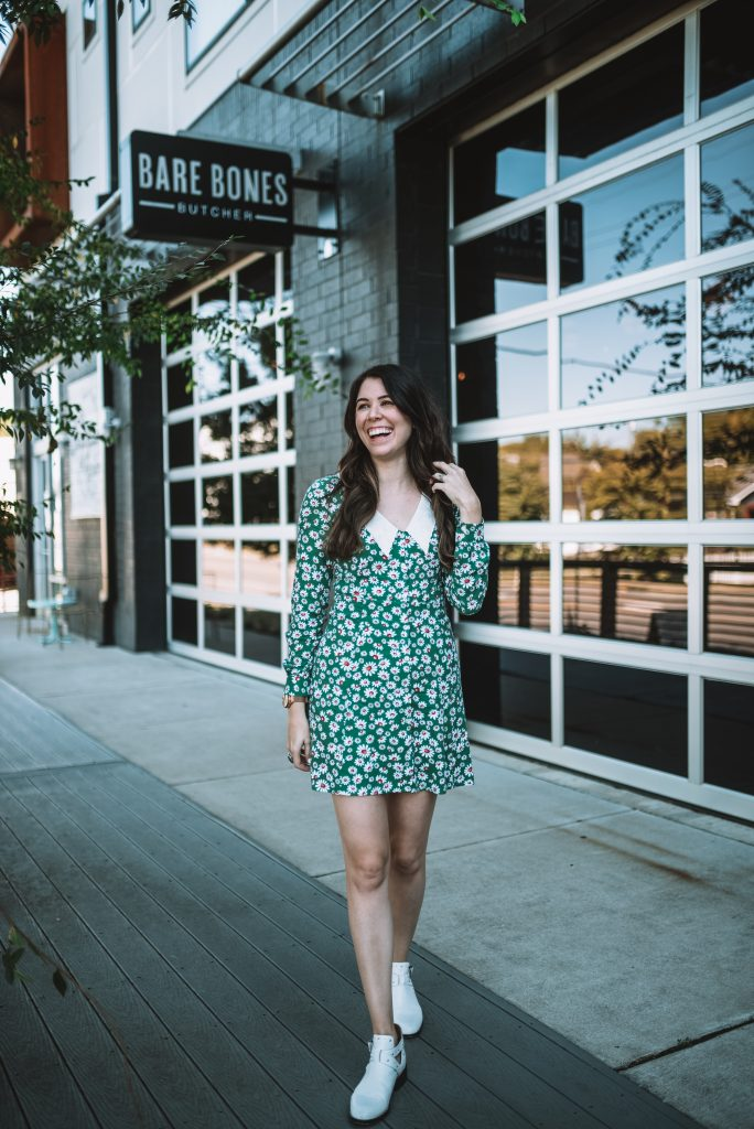 St. Patrick's Day Fashion 3 Outfit Ideas for Tall Women | Greta Hollar |St. Patrick's Day Fashion by popular Nashville tall fashion blogger, Greta Hollar: image of Greta Hollar wearing a green daisy print and white collar dress with white ankle boots.