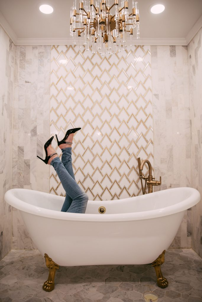 The Ultimate Memphis Trip with your Girlfriends   Greta Hollar   Jeans for Tall Girls by popular Nashville tall fashion blogger, Greta Hollar: image of Greta Hollar lying inside a white and gold clawfoot tub and wearing a pair of skinny jeans and black pumps.