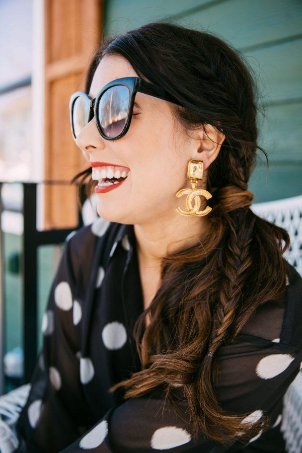 The Ultimate Memphis Trip with your Girlfriends | Greta Hollar |Memphis Trip by popular Nashville travel blogger, Greta Hollar: image of Greta Hollar wearing a black and white polka dot blouse and gold Chanel statement earrings.