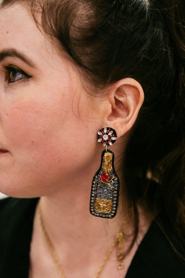 The Ultimate Memphis Trip with your Girlfriends | Greta Hollar |Memphis Trip by popular Nashville travel blogger, Greta Hollar: image of Greta Hollar wearing wine bottle statement earrings.