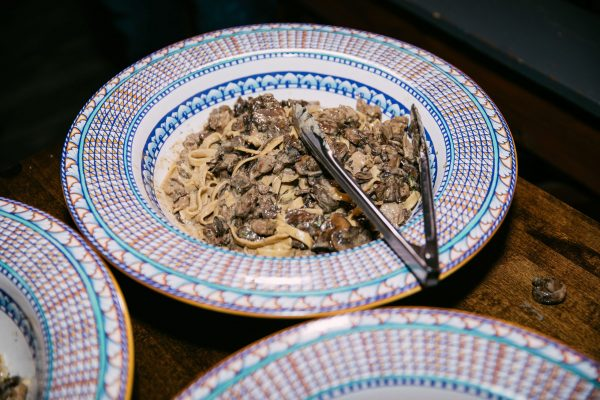 Memphis Trip by popular Nashville travel blogger, Greta Hollar: image of a bowls of food with some serving tongs resting inside.