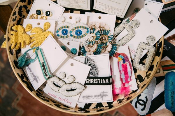 The Ultimate Memphis Trip with your Girlfriends | Greta Hollar |Memphis Trip by popular Nashville travel blogger, Greta Hollar: image of a bowl filled with various statement earrings.